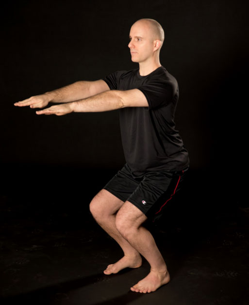 brian-paquette-chair-pose-chagrin-yoga